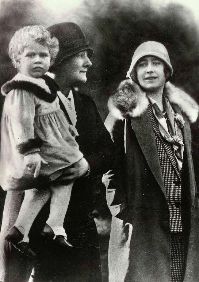 British Royalty The Queen Mother pictured when she was HRH the Duchess of York and her daughter Princess Elizabeth who is held by the nurse, 1928. Photo: Bob Thomas/Popperfoto, Popperfoto/Getty Images / Popperfoto