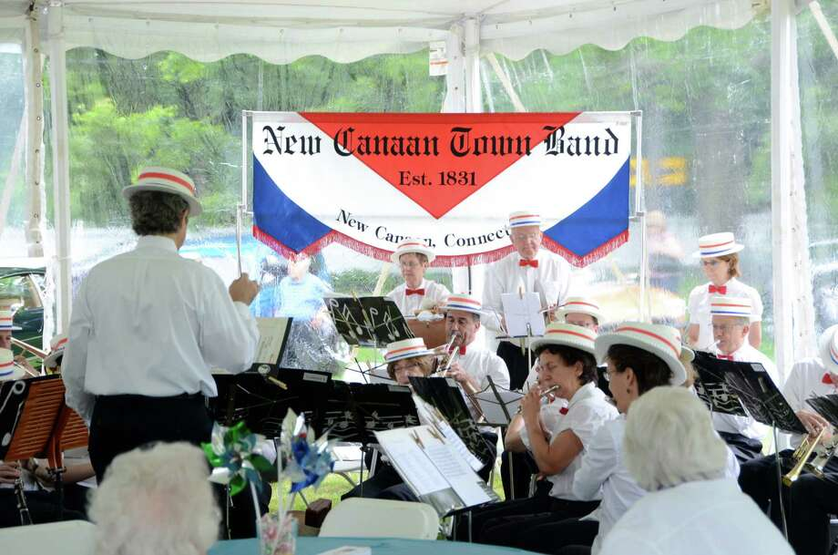 The New Canaan Town Band perform at the 2012 annual ice cream social at the New Canaan Historical Society in New Canaan, Conn. The musicians will be back again this year to entertain the crowds that are expected for this year's social. It will run 1 to 4 p.m., Sunday, June 2, 2013, under a tent on the great lawn of the historical society, 13 Oenoke Ridge. For more information, visit http://www.nchistory.org. Photo: Jeanna Petersen Shepard/file Photo