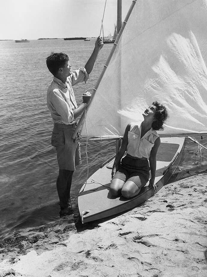 Sailing in Hyannis Port, MA, 1955.Jackie O.'s loose, sleeveless button-down and not-too-short shorts make an ideal outfit for beach activities. Photo: Hulton Archive, Getty