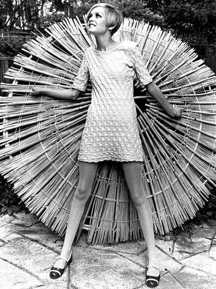 Posing for a photo shoot, 1966.A shift dress paired with flats make for a no-fail outfit that can go from day to night. Photo: Popperfoto, Getty