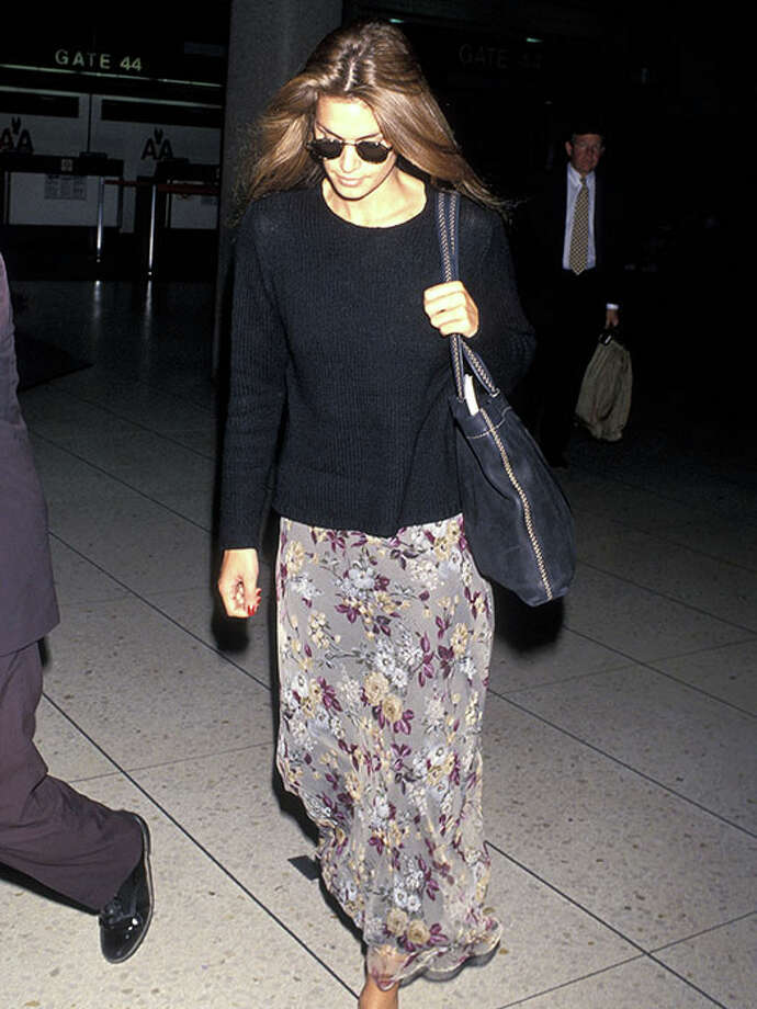 Arriving at LAX in a floral maxi skirt, 1994.A maxi skirt and sweater make for a comfy — but still cute — travel outfit. Photo: Ron Galella, Ltd., Getty / 1994 Ron Galella, Ltd.