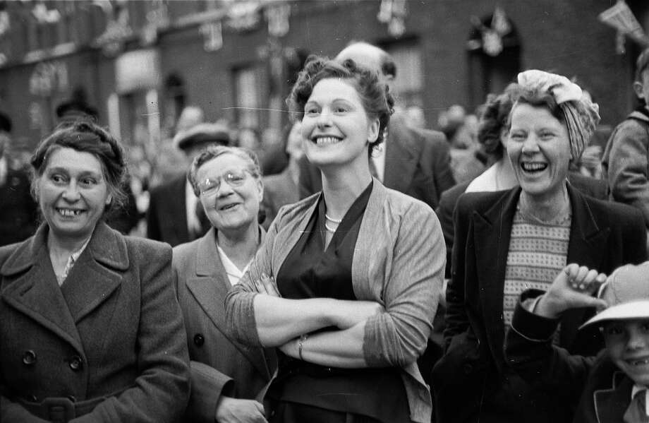 Residents of Morpeth Street in London's East End watching one of the entertainments put on to celebrate the coronation of Queen Elizabeth II. Photo: John Chillingworth, Getty Images / Hulton Royals Collection