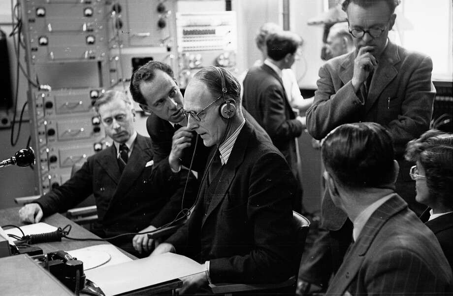 From his base in London's Broadcasting House, S J de Lotbiniere, head of television's outside broadcasting section, coordinates all the movements of the BBC mobile units which will provide coverage of the Coronation of Queen Elizabeth II. Photo: Thurston Hopkins, Getty Images / Picture Post
