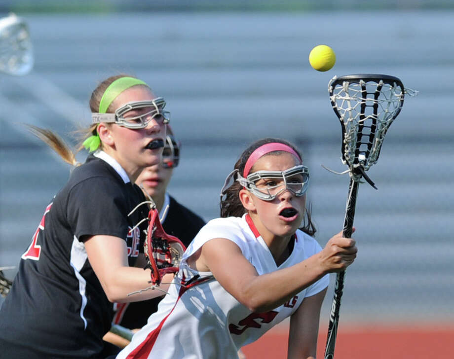At right, Emma Christie (# 5) of Greenwich goes for a loose ball during the first half of the Class L girls lacrosse quarterfinal match between Greenwich High School and Cheshire High School at Greenwich, Thursday, May 30, 2013. Greenwich advanced to the next round as they defeated Cheshire, 19-9. Photo: Bob Luckey / Greenwich Time