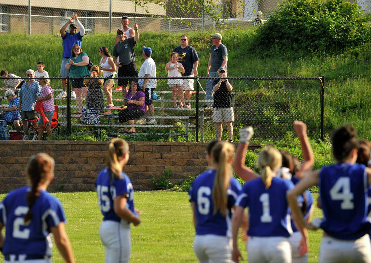 West Haven fans cheer on their team after they beat Westhill, 5-0, in the second round game of the Class LL state softball championship at Westhill High School in Stamford on Thursday, May 30, 2013.