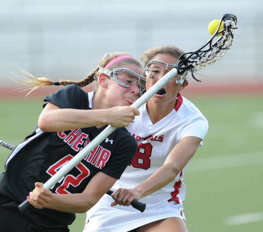At left, Michelle Federico (# 42) of Cheshire loses the ball while being defended by Natalie Paletta (# 18) of Greenwich during the Class L girls lacrosse quarterfinal match between Greenwich High School and Cheshire High School at Greenwich, Thursday, May 30, 2013. Greenwich advanced to the next round as they defeated Cheshire, 19-9. Photo: Bob Luckey / Greenwich Time