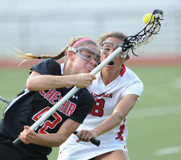 At left, Michelle Federico (# 42) of Cheshire loses the ball while being defended by Natalie Paletta