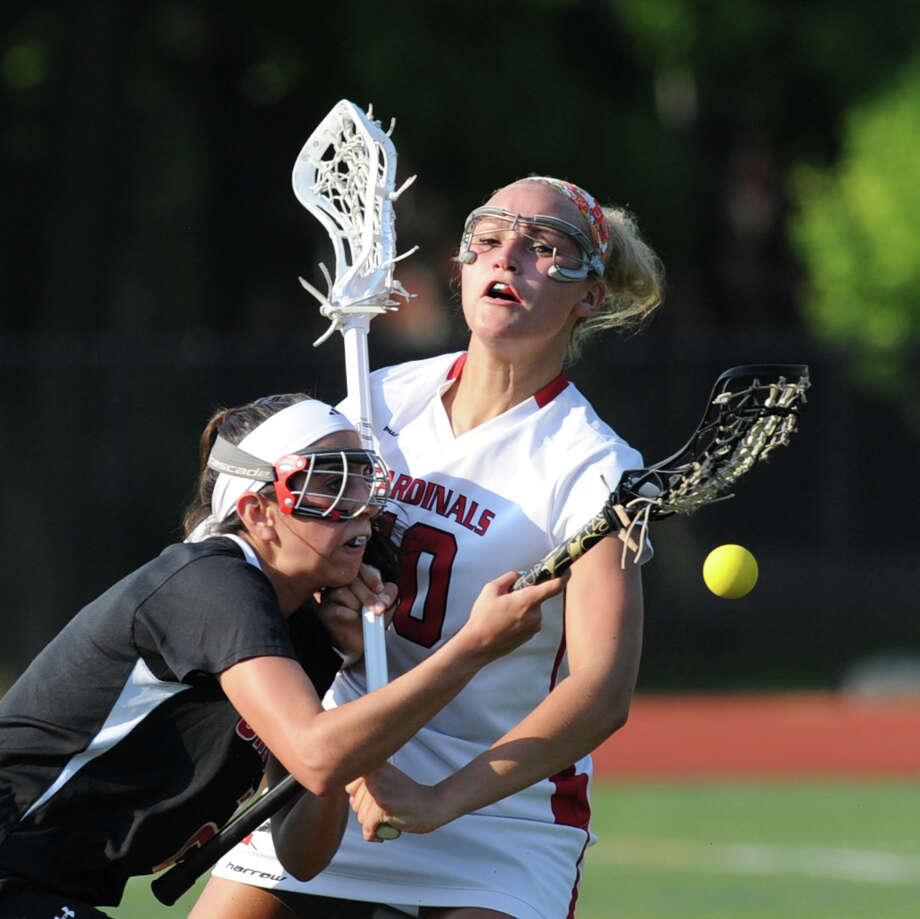 An advancing Cheshire offensive player loses the ball while being defended by Emily Johnson, right, of Greenwich, during the Class L girls lacrosse quarterfinal match between Greenwich High School and Cheshire High School at Greenwich, Thursday, May 30, 2013. Greenwich advanced to the next round as they defeated Cheshire, 19-9. Photo: Bob Luckey / Greenwich Time