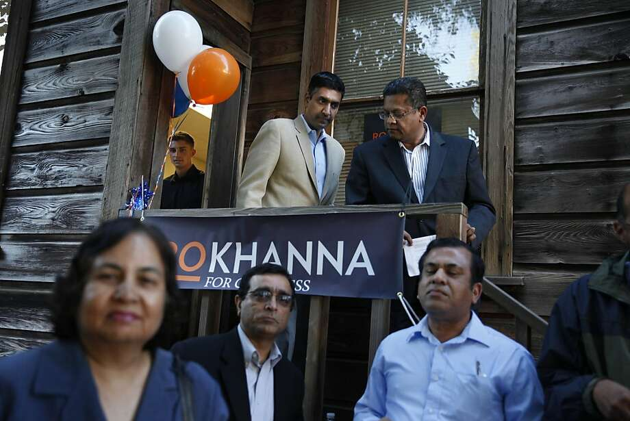 Ro Khanna (center) exits his campaign headquarters in Fremont with Yogi Chugh of the city's planning commission. Photo: Lea Suzuki, The Chronicle