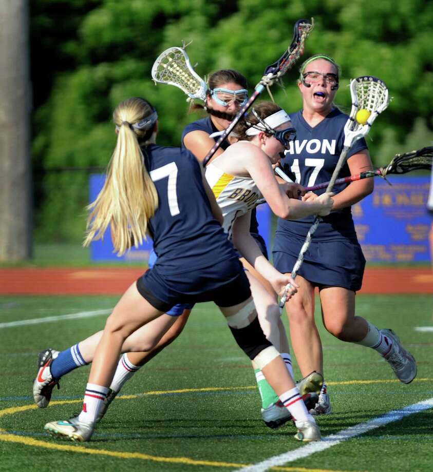 Brookfield's, #1, Tori Weinstock carries the ball in this play Thursday. Brookfield High School girls play Avon High School in a Division M state tournament quarterfinals lacrosse game at Brookfield High School, in Brookfield, Conn. Thursday, May 30, 2013. Photo: Carol Kaliff / The News-Times