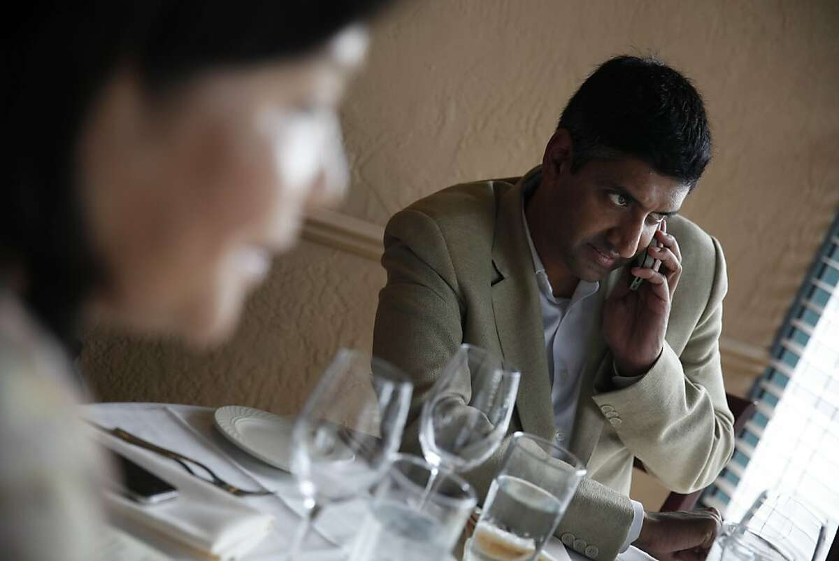 Ro Khanna takes a phone call during a luncheon on Tuesday, May 28, 2013 in Cupertino, Calif. Ro Khanna is running for Congress in California's 17th district.