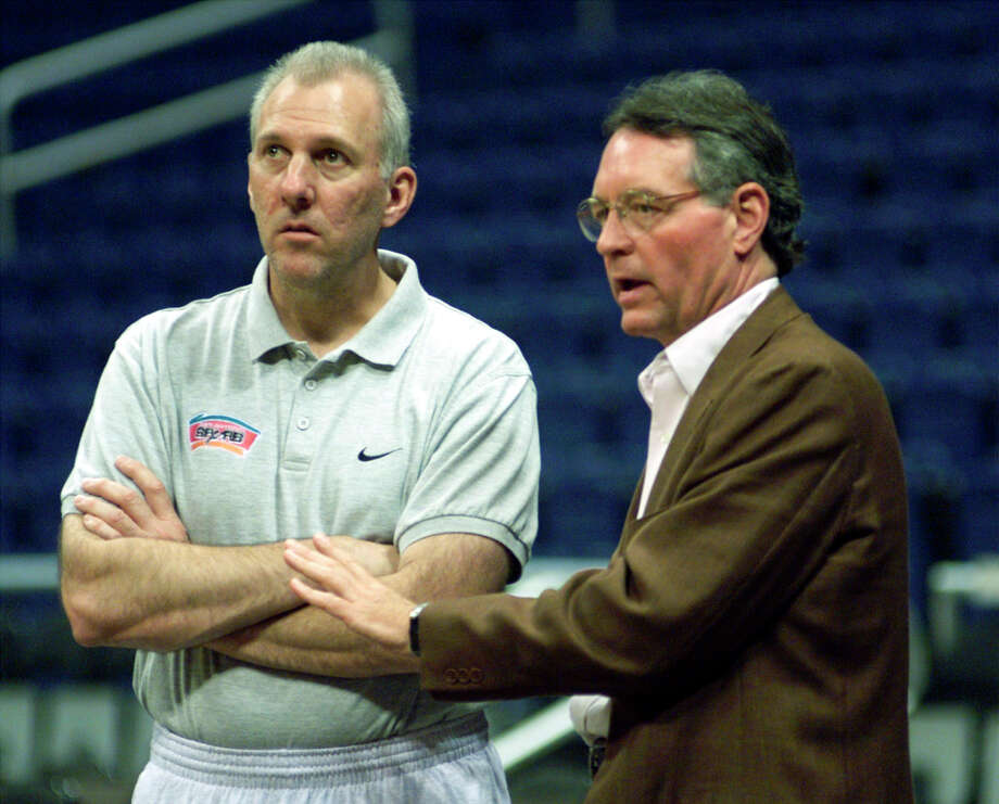 Spurs coach Gregg Popvich (left) and owner Peter Holt watch practice on June 9, 1999 at the Alamodome. Photo: JOE CAVARETTA, EXPRESS NEWS / EXPRESS NEWS