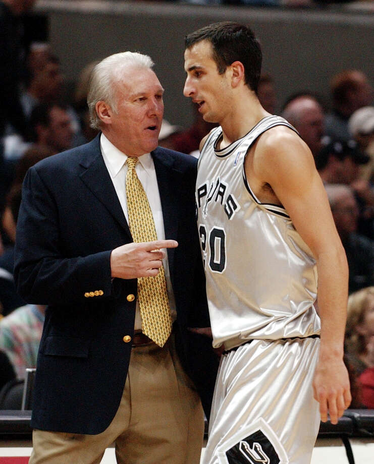Spurs guard Manu Ginobili (left) talks with coach Gregg Popovich as he walks off the court during play against the Philadelphia 76ers in San Antonio, Saturday, Jan. 3, 2004. Photo: ERIC GAY, AP / AP