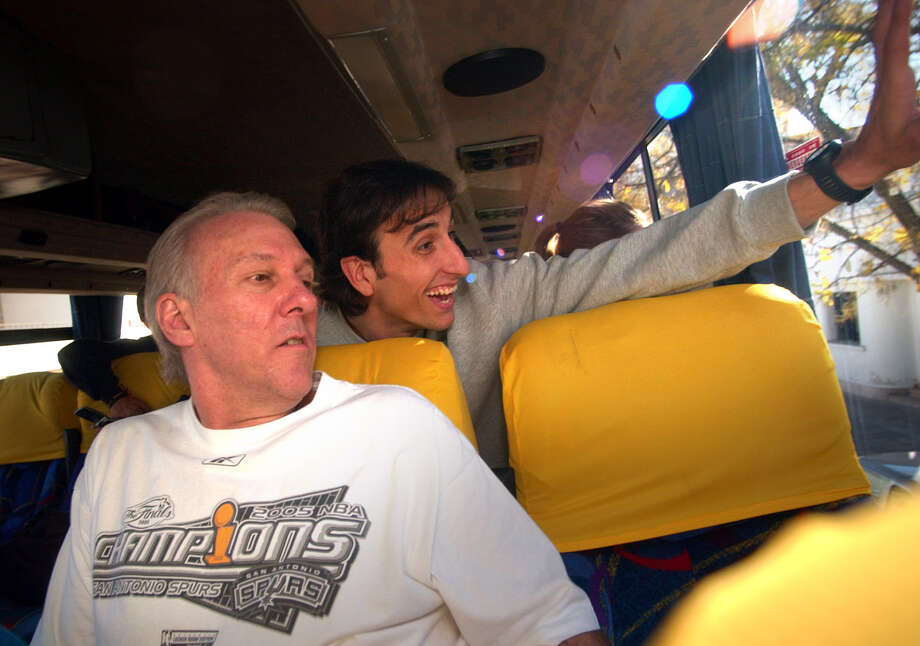Spurs coach Gregg Popovich and guard Manu Ginobili check out the crowd as the team's bus drives through Bahia Blanca, Argentina, Ginobili's hometown, after arriving Monday, July 4, 2005. Photo: BOB OWEN, SAN ANTONIO EXPRESS-NEWS / SAN ANTONIO EXPRESS-NEWS