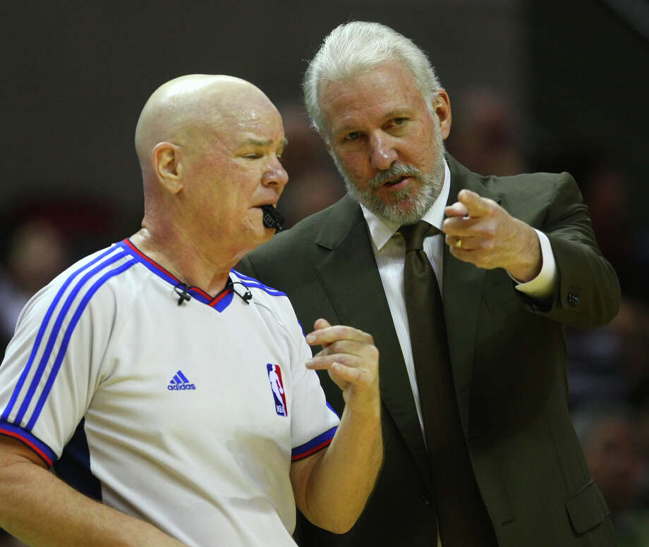 Spurs coach Gregg Popovich talks to referee Joey Crawford on Nov. 26, 2008 at the AT&T Center during the first half of the Spurs' game against the Chicago Bulls. Photo: Wluther@express-news.net