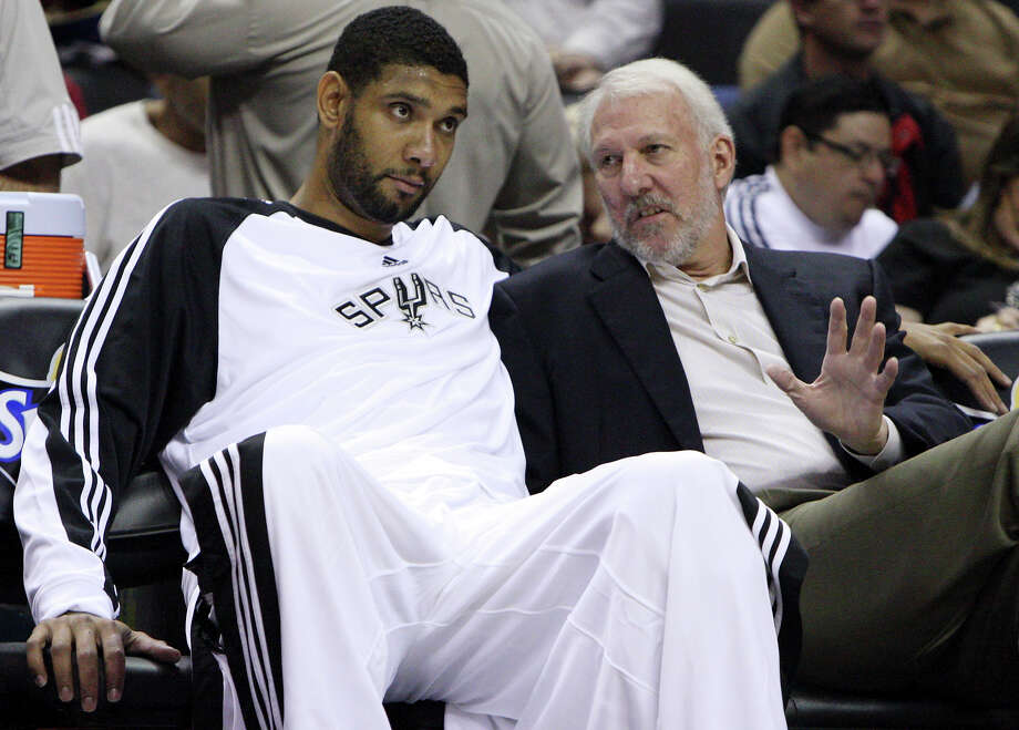 The Spurs' Tim Duncan talks with coach Gregg Popovich prior to the preseason game with Olympiacos on Friday Oct. 9, 2009 at the ATT Center. Photo: EDWARD A. ORNELAS, SAN ANTONIO EXPRESS-NEWS / eaornelas@express-news.net
