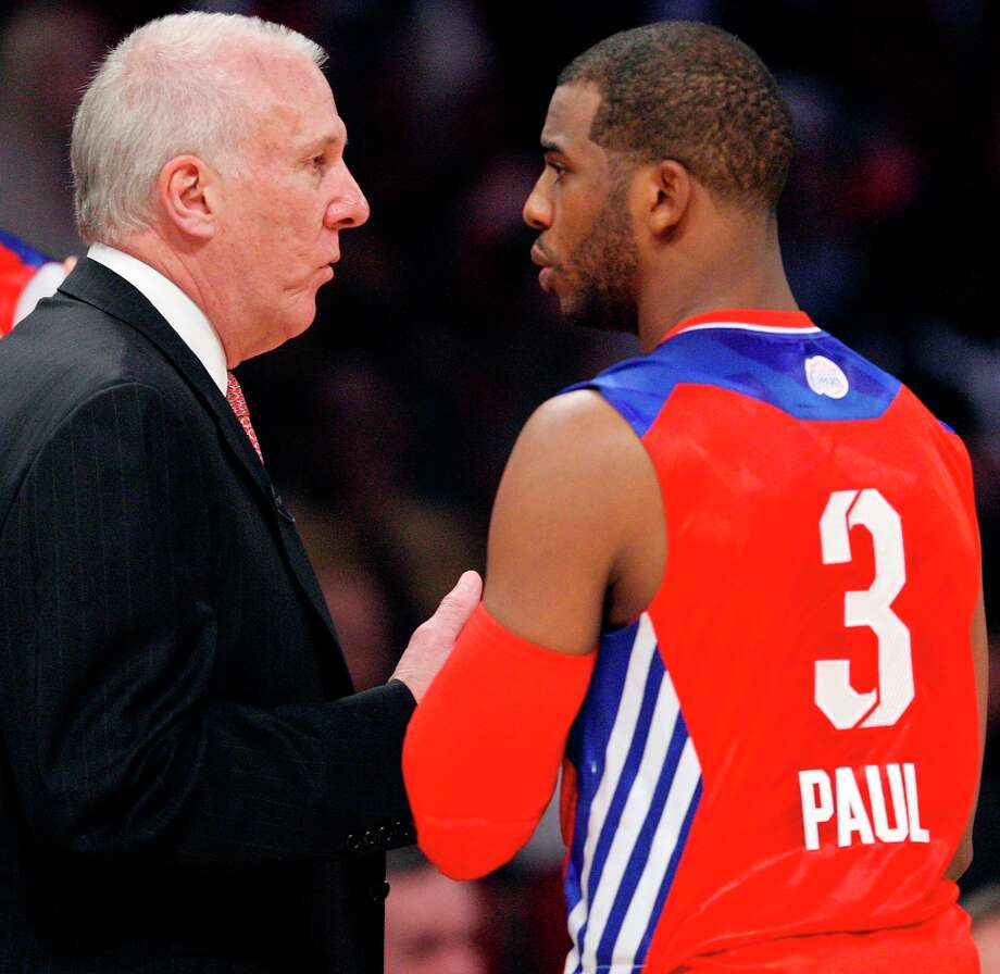 West head coach Gregg Popvich talks with West guard Chris Paul  at the 62nd NBA All-Star Game on Feb. 17, 2013 in Houston. Photo: Edward A. Ornelas, San Antonio Express-News / © 2013 San Antonio Express-News