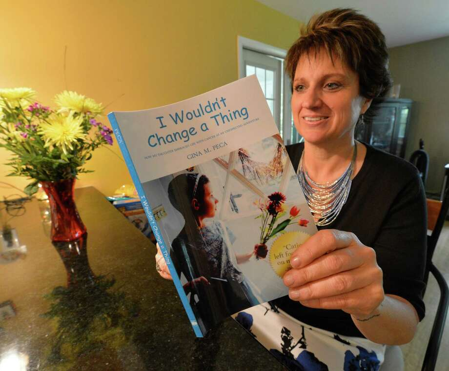 "Gina Peca says her book, ""I Wouldn't Change a Thing,"" is ""the story of a mom and a wife just muddling through.""    (Skip Dickstein/Times Union) Photo: SKIP DICKSTEIN / 00022611A"