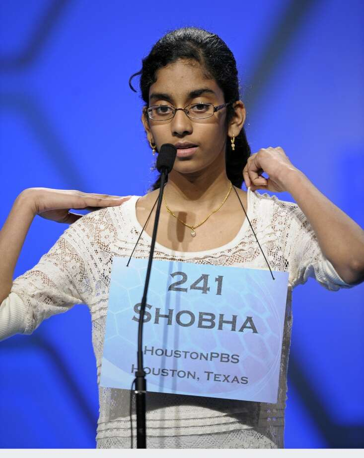 "Shobha Dasari, 12, of Pearland, Texas spells ""spasmolytic"" during the semifinal round of the Scripps National Spelling Bee in Oxon Hill, Md., Thursday, May 30, 2013. (AP Photo/Cliff Owen)"
