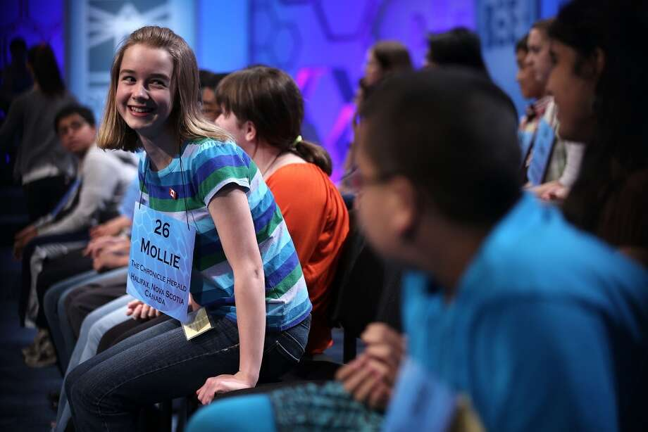 "NATIONAL HARBOR, MD - MAY 29:  Mollie J. Symons of Halifax, Nova Scotia, Canada, returns to her seat after she correctly spelled the word ""ombrology"" in the round three of the 2013 Scripps National Spelling Bee May 29, 2013 at Gaylord National Resort and Convention Center in National Harbor, Maryland. Spellers competed in the annual spelling contest for the championship.  (Photo by Alex Wong/Getty Images)"