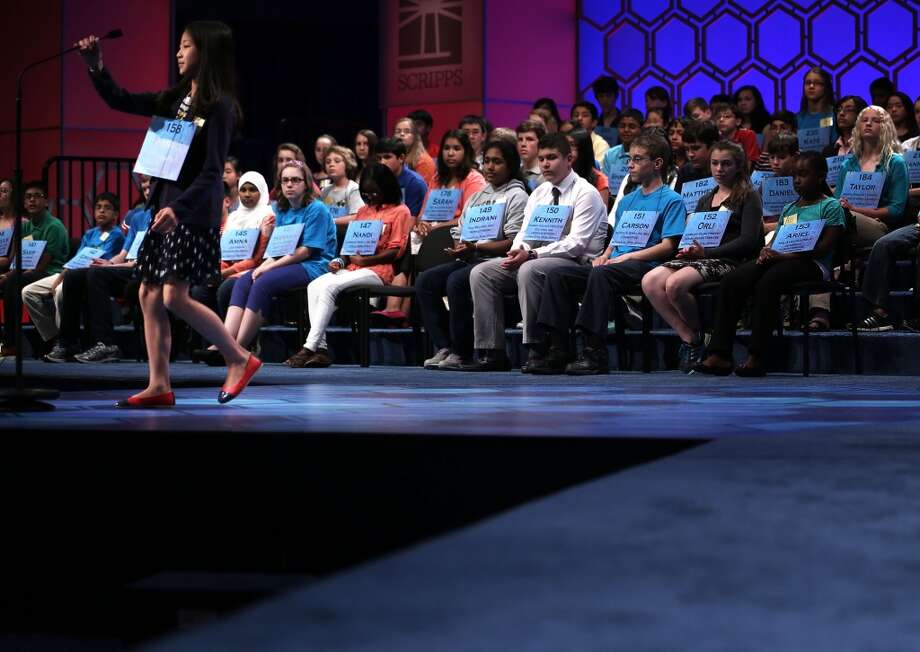 NATIONAL HARBOR, MD - MAY 29:  Maggy Lambo of Gloversville, New York, participates in the round three of the 2013 Scripps National Spelling Bee May 29, 2013 at Gaylord National Resort and Convention Center in National Harbor, Maryland. Spellers competed in the annual spelling contest for the championship.  (Photo by Alex Wong/Getty Images)