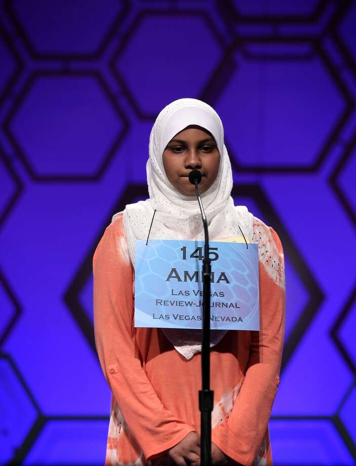 NATIONAL HARBOR, MD - MAY 29:  Amna Raza of Las Vegas, Nevada, participates in the round three of the 2013 Scripps National Spelling Bee May 29, 2013 at Gaylord National Resort and Convention Center in National Harbor, Maryland. Spellers competed in the annual spelling contest for the championship.  (Photo by Alex Wong/Getty Images)