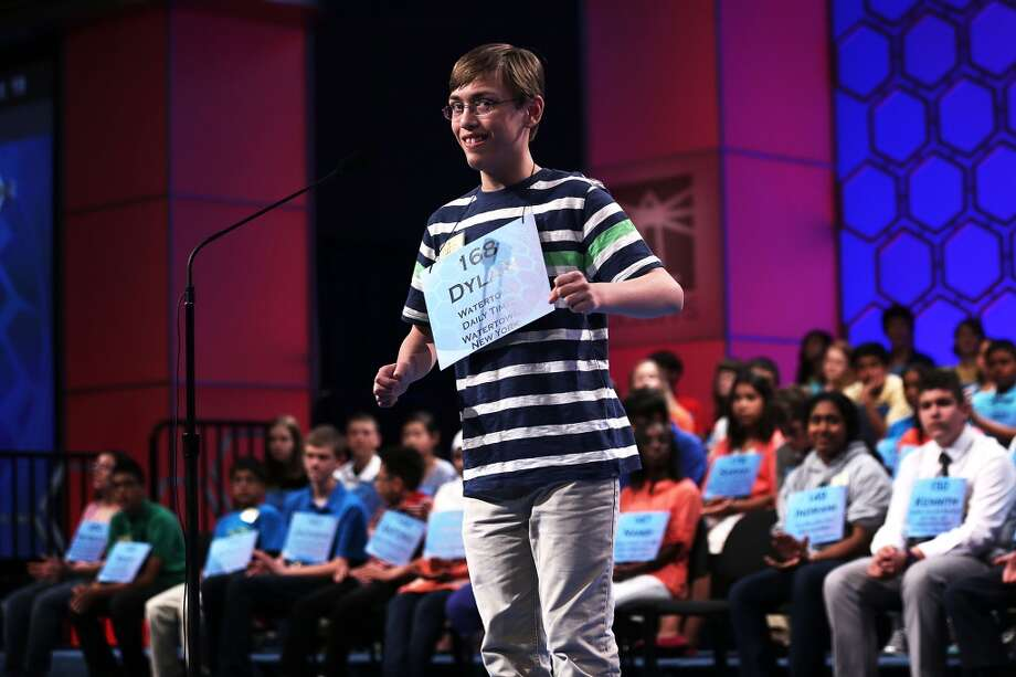 "NATIONAL HARBOR, MD - MAY 29:  Dylan O'Connor of Alexandria Bay, New York, celebrates after he correctly spelled the word ""acervation"" in the round three of the 2013 Scripps National Spelling Bee May 29, 2013 at Gaylord National Resort and Convention Center in National Harbor, Maryland. Spellers competed in the annual spelling contest for the championship.  (Photo by Alex Wong/Getty Images)"