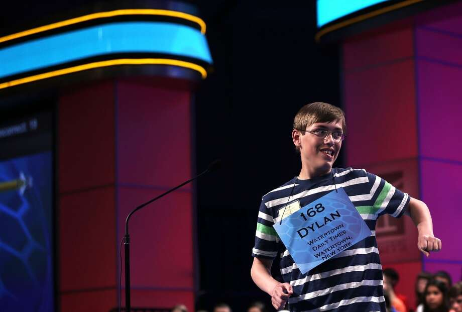"""NATIONAL HARBOR, MD - MAY 29:  Dylan O'Connor of Alexandria Bay, New York, celebrates after he correctly spelled the word """"acervation"""" in the round three of the 2013 Scripps National Spelling Bee May 29, 2013 at Gaylord National Resort and Convention Center in National Harbor, Maryland. Spellers competed in the annual spelling contest for the championship.  (Photo by Alex Wong/Getty Images)"""