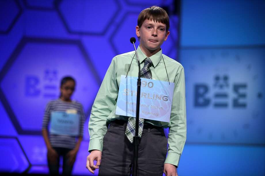 "NATIONAL HARBOR, MD - MAY 29:  Sterling Hollond of Linwood, Kansas, tries to spell a word in the round three of the 2013 Scripps National Spelling Bee May 29, 2013 at Gaylord National Resort and Convention Center in National Harbor, Maryland. Spellers competed in the annual spelling contest for the championship. Hollond misspelled the word ""febrility"" during the round and was eliminated from the competition.  (Photo by Alex Wong/Getty Images)"