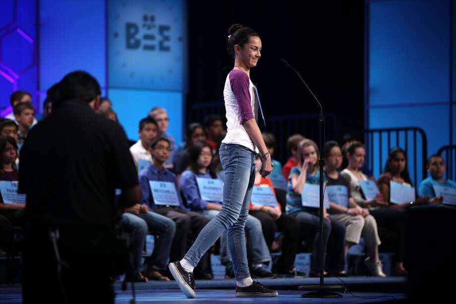 "NATIONAL HARBOR, MD - MAY 29:  Hannah Silvestro of Chino, California, reacts after she misspelled the word ""quadragenarian"" in the round three of the 2013 Scripps National Spelling Bee May 29, 2013 at Gaylord National Resort and Convention Center in National Harbor, Maryland. Spellers competed in the annual spelling contest for the championship.  (Photo by Alex Wong/Getty Images)"