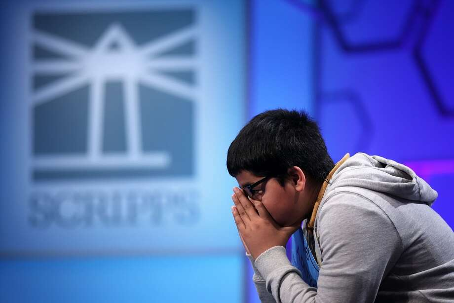 NATIONAL HARBOR, MD - MAY 29: Aditya Mishra of Lincoln, California, waits for his turn to spell in the round three of the 2013 Scripps National Spelling Bee May 29, 2013 at Gaylord National Resort and Convention Center in National Harbor, Maryland. Spellers competed in the annual spelling contest for the championship.  (Photo by Alex Wong/Getty Images)