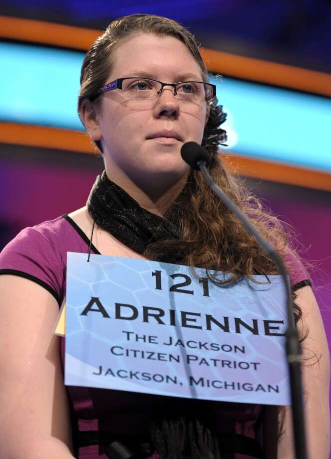 Adrienne Fisher, 14, of Jackson, Miss., spells her word during the second round of the  Scripps National Spelling Bee in Oxon Hill, Md., Wednesday, May 29, 2013. (AP Photo/Cliff Owen)
