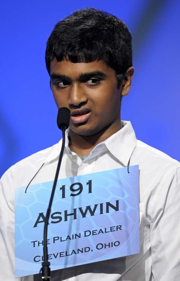 "Ashwin Veeramani, 13, of North Royalton, Ohio, incorrectly spells ""amimia"" during the semifinal round of the Scripps National Spelling Bee in Oxon Hill, Md., Thursday, May 30, 2013. (AP Photo/Cliff Owen)"
