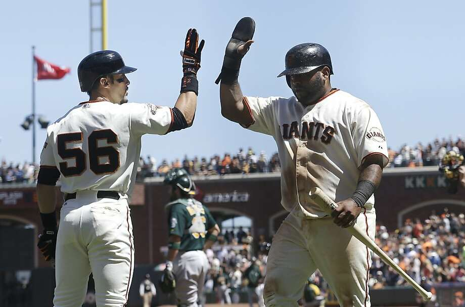 Andres Torres (No. 56) greets Pablo Sandoval after Sandoval scored on Brandon Belt's two-run double. Photo: Jeff Chiu, Associated Press