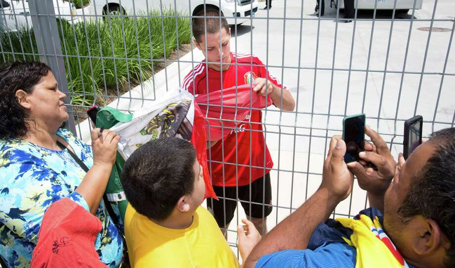 "Javier ""El Chicarito"" Hernandez of the Mexico National Team soccer signs autographs after the team practiced, May 28, 2013 in Houston at Dynamo Stadium. Photo: Eric Kayne, For The Chronicle / 2013 Eric Kayne"