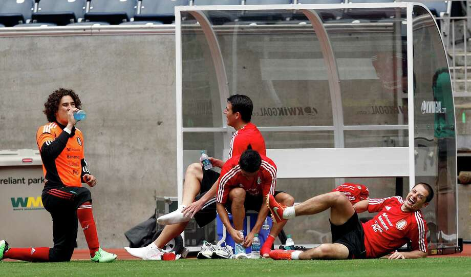 """Javier """"El Chicharito"""" Hernandez, right, and members of the Mexico National Team wind down after their morning practic session, Thursday, May 30, 2013 at Reliant Stadium. Photo: Bob Levey, For The Chronicle / ©2013 Bob Levey"""