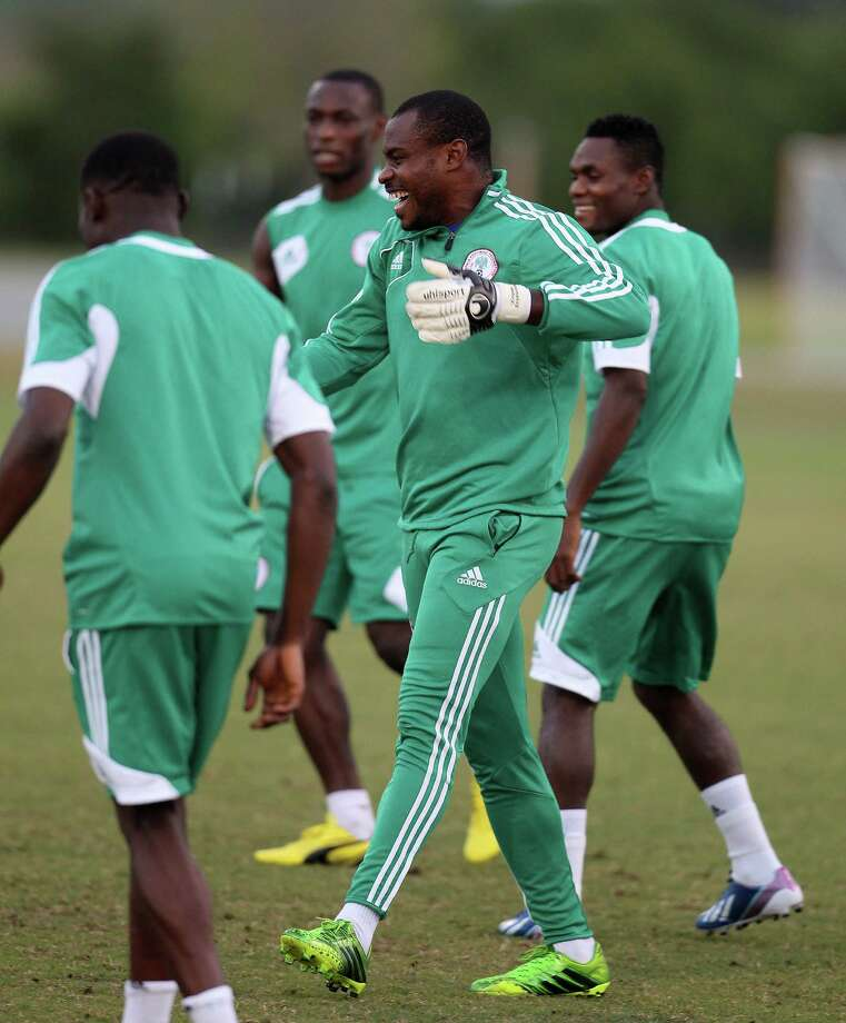 Vincent Enyeama, goalkeeper for the Nigeria National Team, laughs during soccer practice at the Houston Amateur Sports Park, Wednesday, May 29, 2013, in Houston, as they prepare for Friday's game against Mexico National. Photo: Karen Warren, Houston Chronicle / © 2013 Houston Chronicle