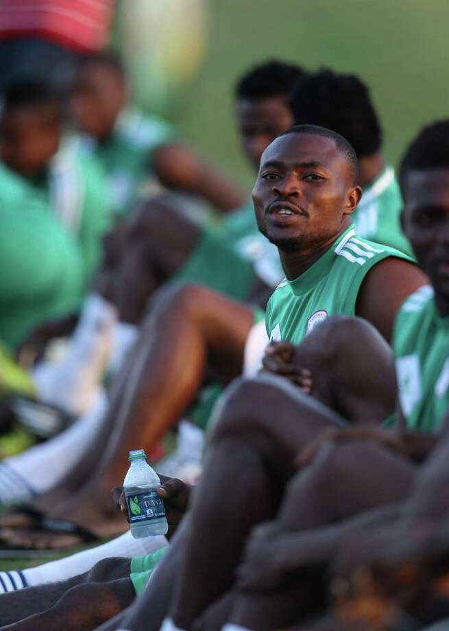 Members of the Nigeria National Team put on their shoes before soccer practice at the Houston Amateur Sports Park, Wednesday, May 29, 2013, in Houston, as they prepare for Friday's game against Mexico National. Photo: Karen Warren, Houston Chronicle / © 2013 Houston Chronicle
