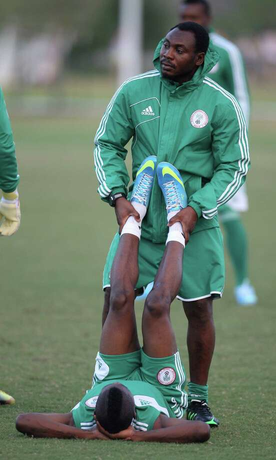 A member of the Nigeria National Team gets help stretching during soccer practice at the Houston Amateur Sports Park, Wednesday, May 29, 2013, in Houston, as they prepare for Friday's game against Mexico National. Photo: Karen Warren, Houston Chronicle / © 2013 Houston Chronicle