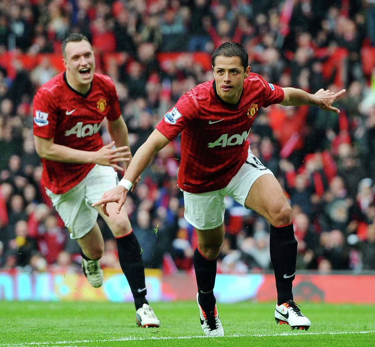 Manchester United's Mexican forward Javier Hernandez (C) celebrates scoring the opening goal during the English Premier League football match between Manchester United and Swansea City at Old Trafford in Manchester, northwest England, on May 12, 2013. AFP PHOTO / ANDREW YATES RESTRICTED TO EDITORIAL USE. No use with unauthorized audio, video, data, fixture lists, club/league logos or é¢Â€Âœliveé¢Â€Â services. Online in-match use limited to 45 images, no video emulation. No use in betting, games or single club/league/player publicationsANDREW YATES/AFP/Getty Images