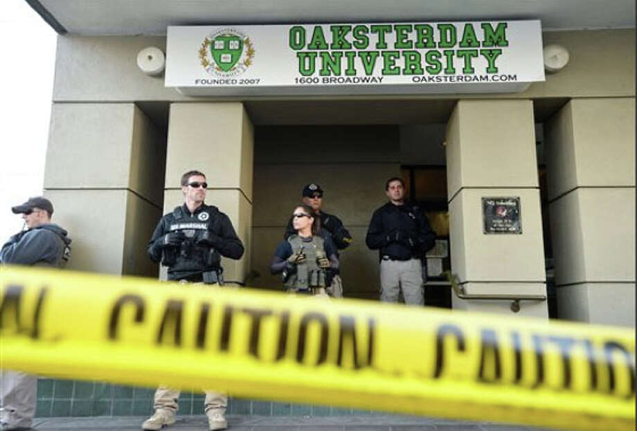 President Obama's past and his apparent desire to leave marijuana users alone led many to be surprised when federal agents began cracking down hard on medical marijuana growers and dispensaries. The feds said the arrested were doing more with their pot and money than serving medical patients.   Photo: U.S. marshals stand at the entrance of Oaksterdam University in Oakland, Calif., in 2012. The federal agents raided the medical marijuana training school at the heart of California's pot legalization movement.   Obama tried to clarify the issue in an interview with the Rolling Stone in April: ''The only tension that's come up – and this gets hyped up a lot – is a murky area where you have large-scale, commercial operations that may supply medical marijuana users, but in some cases may also be supplying recreational users. In that situation, we put the Justice Department in a very difficult place if we're telling them, 'This is supposed to be against the law, but we want you to turn the other way.' That's not something we're going to do.''