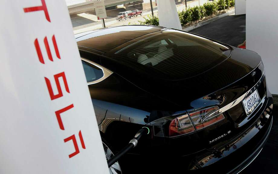 A Model S sedan charges up during the October grand opening of a Tesla supercharger station in Lebec,  Calif. Tesla's CEO said Thursday that 80 percent of the U.S. would have access to such stations by 2014. Photo: Patrick T. Fallon / © 2012 Bloomberg Finance LP