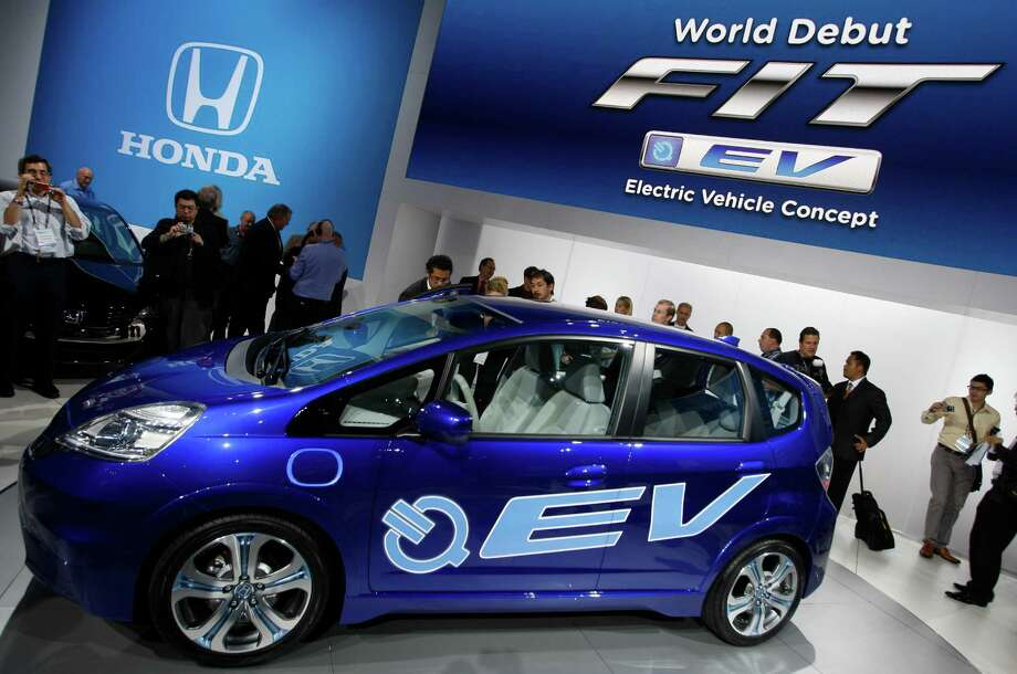 FILE- In this Nov. 17, 2010, file photo, Honda introduces its new FIT EV Electric Vehicle Concept car at the LA Auto Show Wednesday, in Los Angeles. Auto companies in the U.S. are lowering lease prices for electric cars as they try to jump-start slow sales in a competitive market. ( AP Photo/Damian Dovarganes) Photo: Damian Dovarganes, STF / AP
