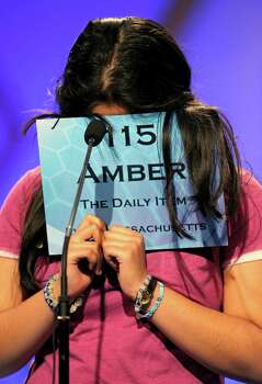 "Amber Born, 14 of Marblehead, Mass., covers her face while spelling ""malacophilous"" during the semifinal round of the Scripps National Spelling Bee in Oxon Hill, Md., Thursday, May 30, 2013. Photo: Cliff Owen, Associated Press / FR170079 AP"