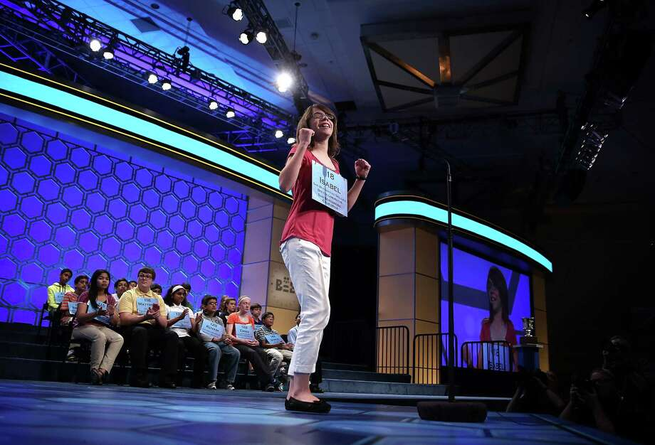 Isabel Cholbi of San Bernardina, California, celebrates after she correctly spelled her word in the round five of the 2013 Scripps National Spelling Bee May 30, 2013 at Gaylord National Resort and Convention Center in National Harbor, Maryland. Forty-two have advanced to the semifinal of the annual spelling contest for the championship. Photo: Alex Wong, Getty Images / 2013 Getty Images