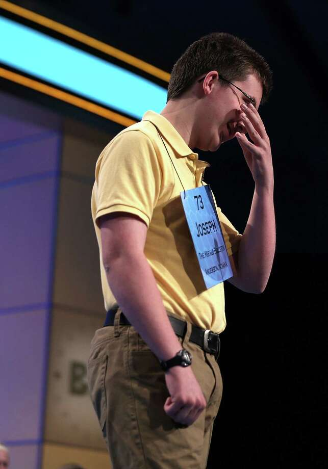 Joseph Kirkpatrick of Anderson, Indiana, reacts after he misspelled his word in round five of the 2013 Scripps National Spelling Bee May 30, 2013 at Gaylord National Resort and Convention Center in National Harbor, Maryland. Forty-two have advanced to the semifinal of the annual spelling contest for the championship. Photo: Alex Wong, Getty Images / 2013 Getty Images
