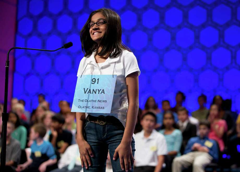 "Vanya Shivashankar, 11 of Olathe, Kan., smiles after spelling the word ""shillibeer"" correctly during the final round of the National Spelling Bee on Thursday, May 30, 2013, in Oxon Hill, Md. Photo: Evan Vucci, Associated Press / AP"