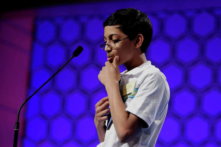 """Arvind Mahankali, 13, of Bayside Hills, N.Y., concentrates on his word """"galere"""" before spelling it correctly during the final round of the National Spelling Bee on Thursday, May 30, 2013, in Oxon Hill, Md. Photo: Evan Vucci, Associated Press / AP"""