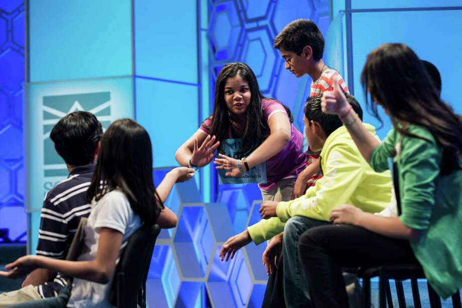 Amber Born, representing Massachusetts, is cheered on by her competitors during the championship round at the Scripps National Spelling Bee May 30, 2013 in National Harbor, Maryland. Photo: BRENDAN SMIALOWSKI, AFP/Getty Images / Brendan SMIALOWSKI
