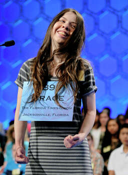 "Grace Remmer, 14, of St. Augustine, Fla., reacts to correctly spelling ""greffier' during the finals of the Scripps National Spelling Bee in Oxon Hill, Md., Thursday, May 30, 2013. Photo: Cliff Owen, Associated Press / FR170079 AP"